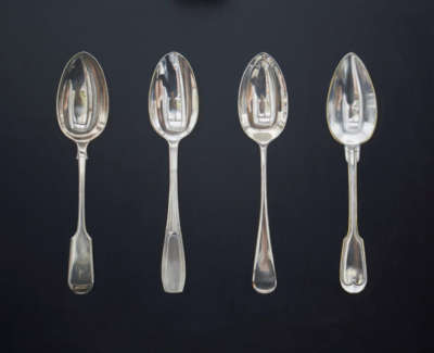 Silver Spoons On Black